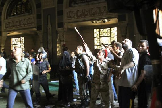 A soldier points to the second floor of the Fateh mosque during an exchange of fire during the standoff in Ramses Square.