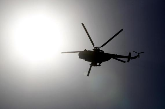 An Egyptian army helicopter over Ramses Square.