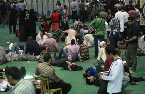 Demonstrators wait inside the Fateh mosque during the standoff.