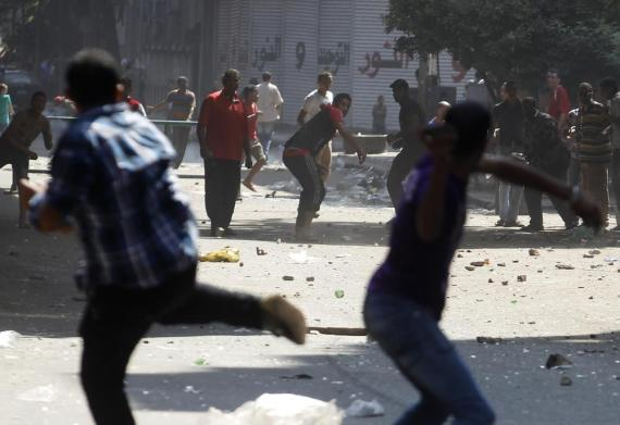 Protesters clash with opponents outside Azbkya police station near Ramses Square in Cairo.