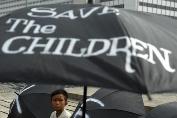 seorang-anak-mengikuti-aksi-menentang-kekerasan-seksual-terhadap-anak-_140520204318-918